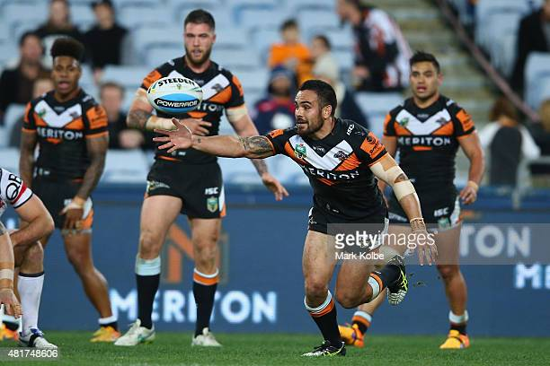 Dene Halatau of the Wests Tigers loses the ball during the round 20 NRL match between the Wests Tigers and the Sydney Roosters at ANZ Stadium on July...