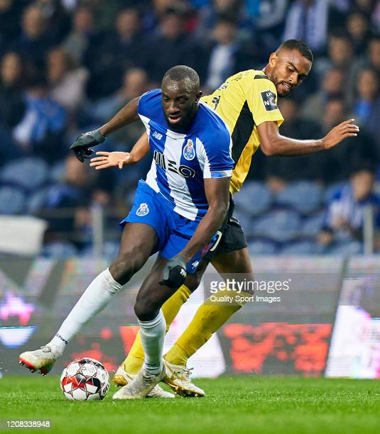 Dener Gomes Clemente of Portimonense SC competes for the ball with Moussa Marega of FC Porto during the Liga Nos match between FC Porto and...