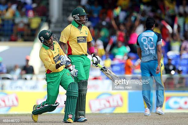 Denesh Ramdin and Chris Barnwell celebrate winning over the St Lucia Zouks during a match between Guyana Amazon Warriors and St Lucia Zouks as part...