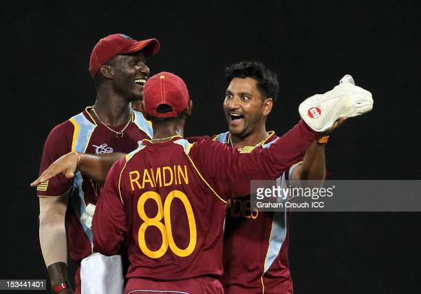 Denesh Ramdin and Ravi Rampaul of West Indies celebrate after dismissing Cameron White of Australia during the ICC World T20 Semi Final between...