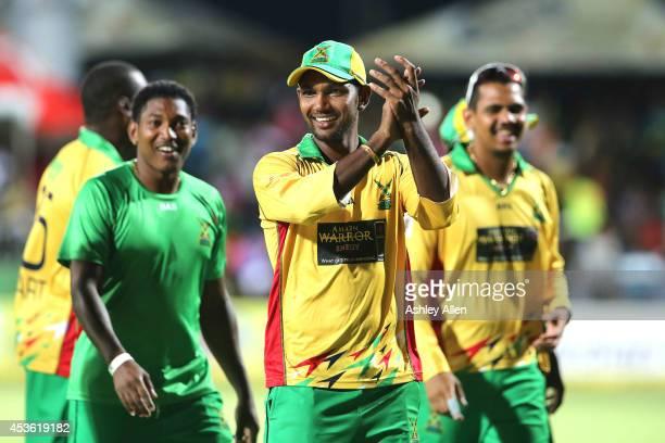 Denesh Ramdin Krishmar Santokie and Sunil Narine celebrate winning over the Jamaica Tallawahs by 10 wickets during the Semifinal match between...