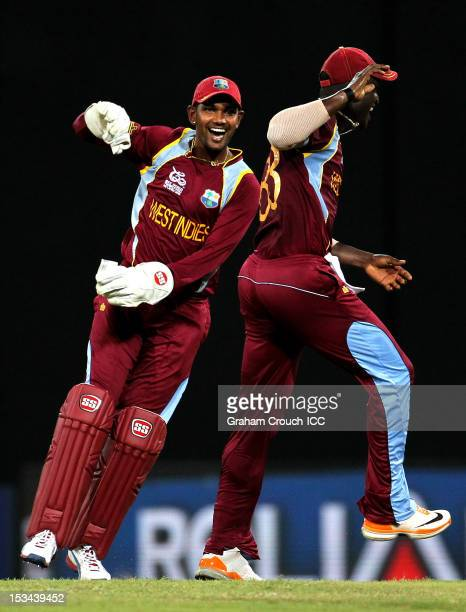 Denesh Ramdin of West Indies celebrates after taking a catch to dismiss Cameron White of Australia during the ICC World T20 Semi Final between...