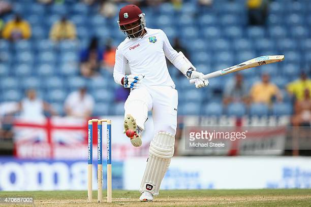 Denesh Ramdin of West Indies kicks the ball away from hitting his wickets off a Chris Jordan delivery during day two of the 2nd Test match between...
