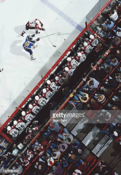 Denfenceman Aaron Miller of the Colorado Avalanche tackles Tony Twist Left Winger for the St Louis Blues as the Avalanche players look on from the...