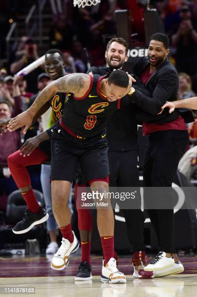 Deng Adel Kevin Love and Tristan Thompson the Cleveland Cavaliers joke with teammate Channing Frye during the second half at Rocket Mortgage...