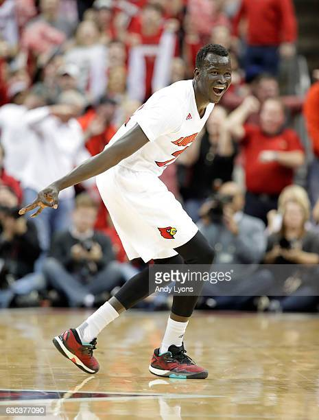 Deng Adel of the Louisville Cardinals celebrates after making a three point shot during the game against the Kentucky Wildcats at KFC YUM Center on...