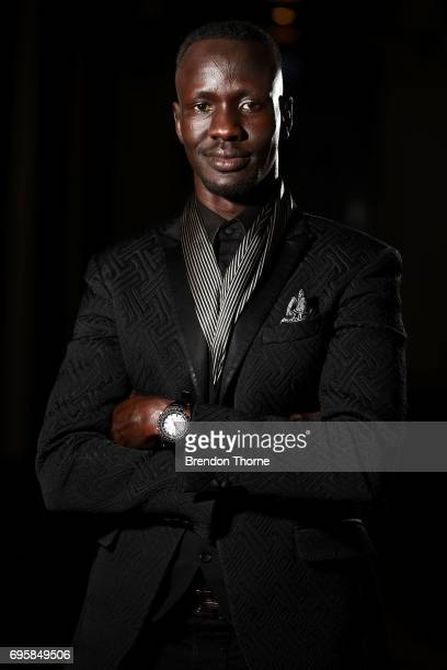 Deng Adut 2017 NSW Australian of the Year poses prior to 'RightsTalk Inspiring change in human rights' at Sydney Town Hall on June 14 2017 in Sydney...
