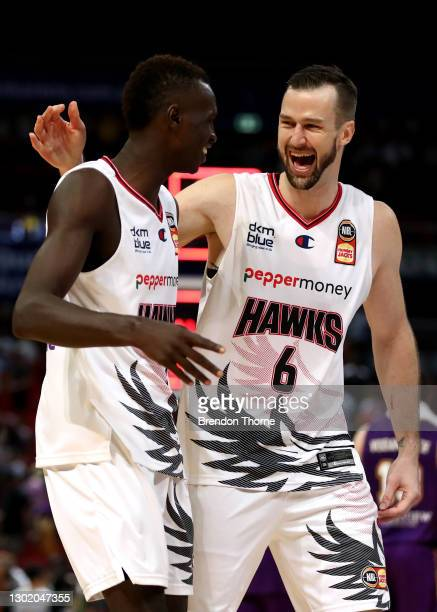 Deng Deng and AJ Ogilvy of the Hawks celebrate during the round five NBL match between the Sydney Kings and the Illawarra Hawks at Qudos Bank Arena,...