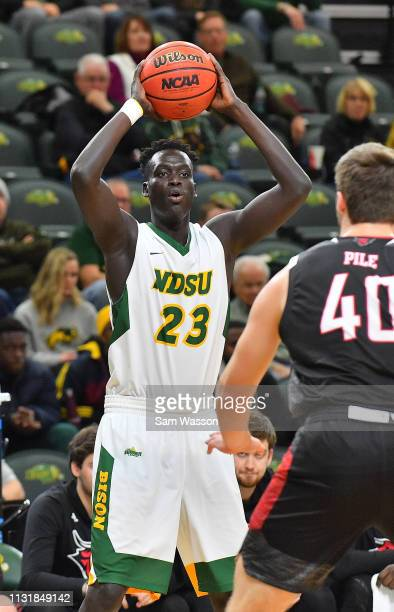 Deng Geu of the North Dakota State Bison looks to pass against Matt Pile of the Omaha Mavericks during their game at Scheels Center on February 23...