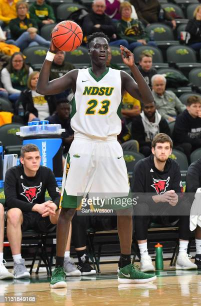 Deng Geu of the North Dakota State Bison looks to pass against the Omaha Mavericks during their game at Scheels Center on February 23 2019 in Fargo...