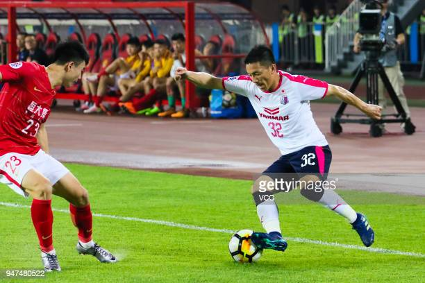 Deng Hanwen of Guangzhou Evergrande and Atomu Tanaka of Cerezo Osaka compete for the ball during the AFC Champions League Group G match between...