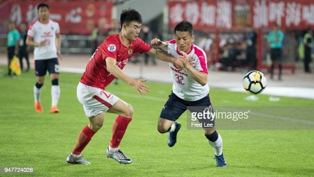 Deng hanwen of Guangzhou Evergrande Taobao and Atomu Tanaka of Cerezo Osaka in action during the 2018 AFC Champions League Group G match between...