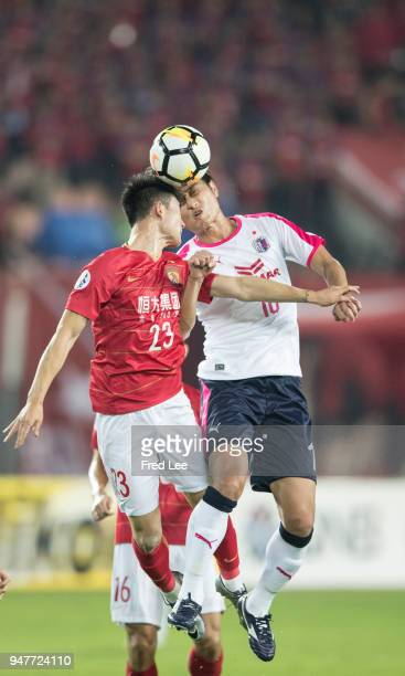 Deng hanwen of Guangzhou Evergrande Taobao and Yang DongHyun of Cerezo Osaka in action during the 2018 AFC Champions League Group G match between...