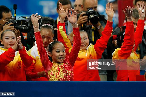 Deng Linlin of China celebrates after China won the gold medal in the artistic gymnastics team event at the National Indoor Stadium during Day 5 of...