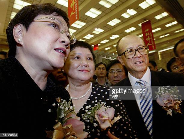 Deng Nan second daughter of the late Chinese paramount leader Deng Xiaoping and her younger sister Deng Rong are accompanied by Hong Kong tycoon Li...