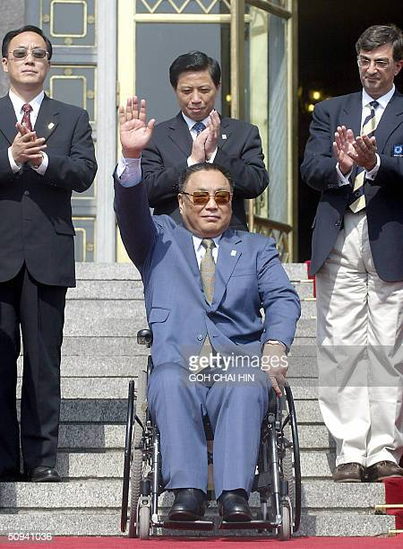 Deng Pufang the wheelchairbound son of the late paramount leader Deng Xiaoping and chairman of China Disabled Persons' Federation waves on the steps...