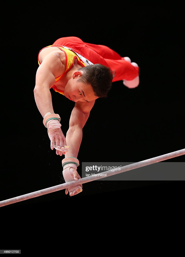 Deng Shudi of China competes on the High Bar during day eight of World Artistic Gymnastics Championships at The SSE Hydro on October 30, 2015 in Glasgow, Scotland.
