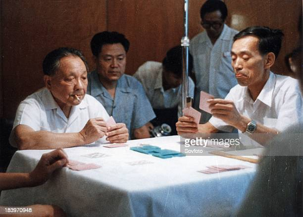 Deng Xiaoping playing bridge at a bridge game for the aged held in Beijing on June 24, 1984. His team came fist in Group A. The game was sponsored by...