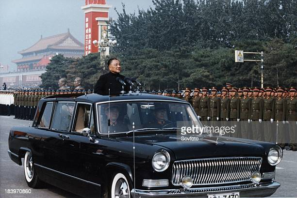 Deng Xiaoping reviewing the honor guard of the three services during the celebration of the 35th anniversary of the founding of the People's Republic...
