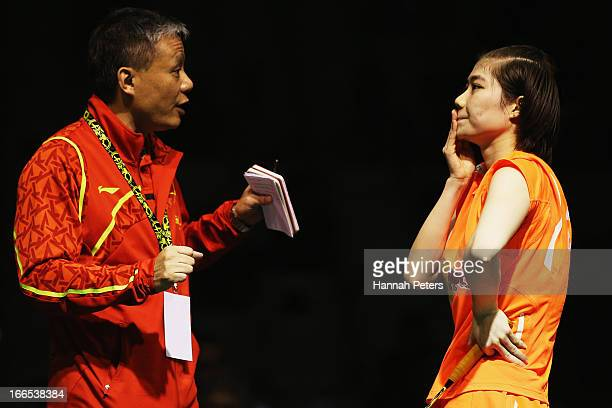 Deng Xuan of China listens to her coach during the New Zealand Badminton Open Women's Singles final match between Yamaguchi Akane of Japan and Deng...