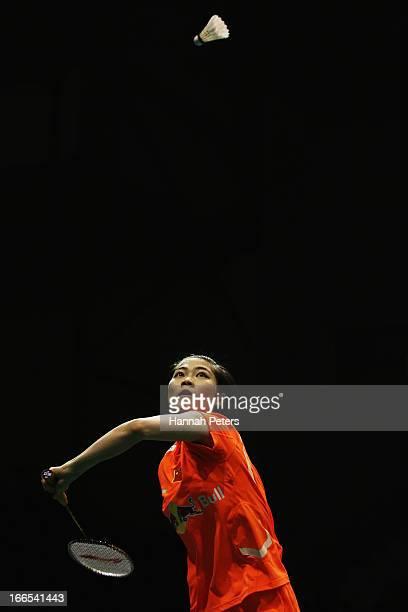 Deng Xuan of China plays a shot during the New Zealand Badminton Open Women's Singles final match between Yamaguchi Akane of Japan and Deng Xuan of...