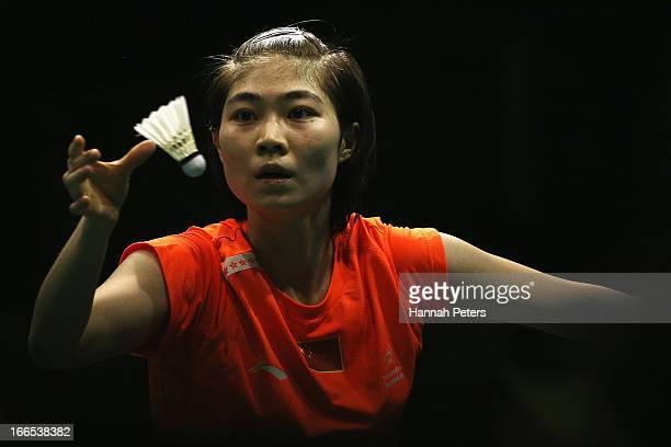 Deng Xuan of China serves during the New Zealand Badminton Open Women's Singles final match between Yamaguchi Akane of Japan and Deng Xuan of China...