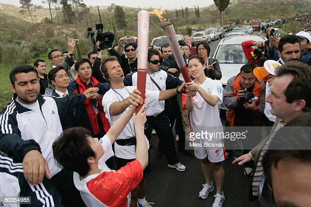 Deng Yaping and Luo Xuejuan the Chinese torchbearers during the Lighting Ceremony of the Olympic Flame at Ancient Olympia on March 24 2008 in...