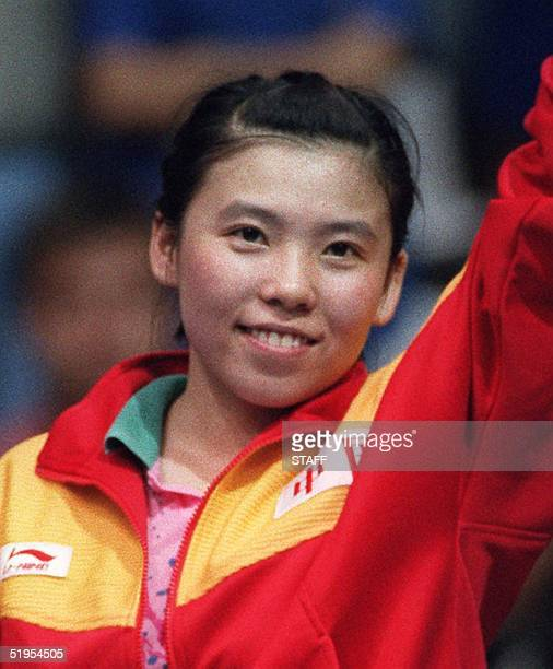 Deng Yaping of China smiles on the podium after winning, with teammate Qiao Hong, the gold medal in the women's double table tennis final at the...