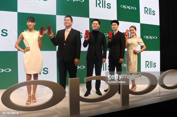 Deng Yuchen head of the Japanese arm of Chinese smartphone maker Oppo poses for photos during a press conference in Tokyo on Jan 31 announcing a plan...
