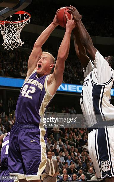 Denham Brown of the Connecticut Huskies goes for the block against Mike Jensen of the Washington Huskies during the Regionals of the NCAA Men's...