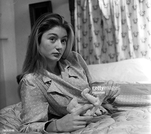 Denham Village England 17 year old French actress Anouk Aimee who is in England to act in the film 'Golden Salamander' is pictured holding a teddy...