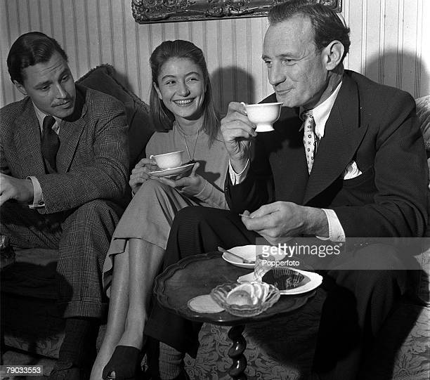 """Denham Village, England 17 year old French actress Anouk Aimee who is in England to act in the film """"Golden Salamander"""" is pictured with actors Ivan..."""