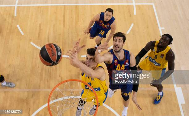 Deni Avdija #8 of Maccabi Fox Tel Aviv competes with Ante Tomic #44 of FC Barcelona during the 2019/2020 Turkish Airlines EuroLeague Regular Season...