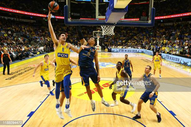Deni Avdija #8 of Maccabi Fox Tel Aviv competes with Jacob Wiley #0 of Herbalife Gran Canaria during the 2018/2019 Turkish Airlines EuroLeague...