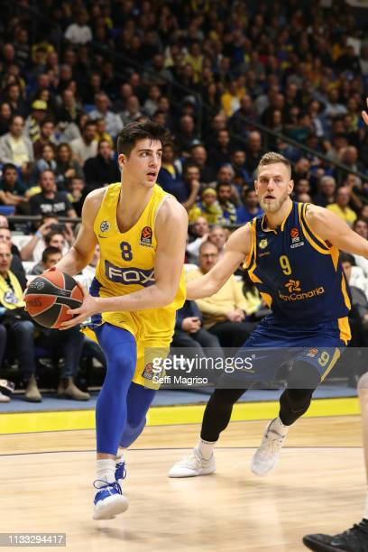 Deni Avdija #8 of Maccabi Fox Tel Aviv competes with SiimSander Vene #9 of Herbalife Gran Canaria during the 2018/2019 Turkish Airlines EuroLeague...