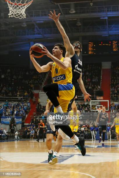 Deni Avdija of Maccabi FOX Tel Aviv and Evgeny Voronov of Zenit St Petersburg in action during the EuroLeague Basketball match between Zenit St...