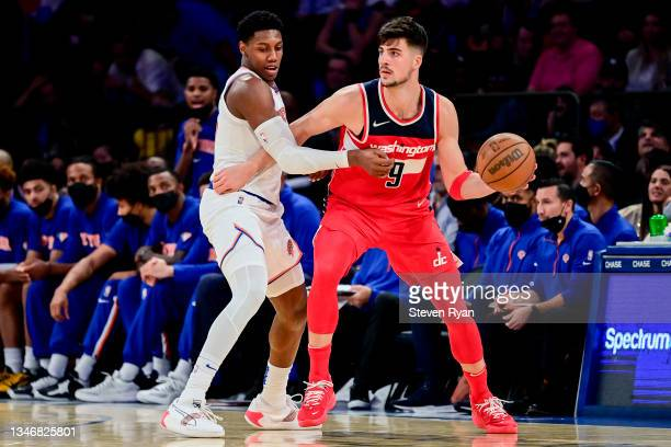 Deni Avdija of the Washington Wizards is defended by RJ Barrett of the New York Knicks during a preseason game at Madison Square Garden on October...