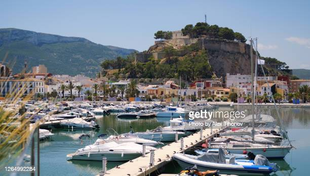 denia castle and harbour. spain - denia stock pictures, royalty-free photos & images