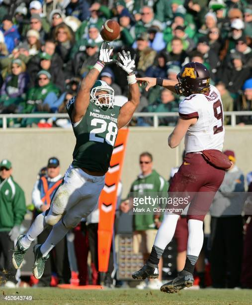 Denicos Allen of the Michigan State Spartans deflects a pass thrown by Philip Nelson of the Minnesota Golden Gophers in the third quarter of the game...