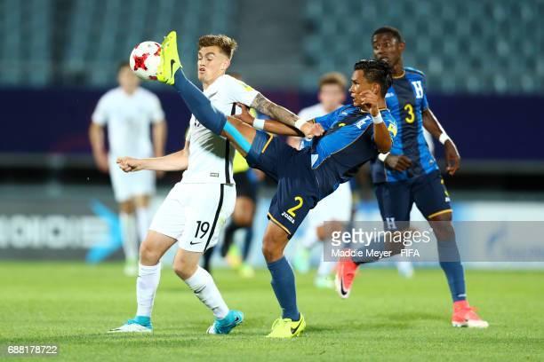 Denil Maldonado of Honduras wins the ball over Myer Bevan of New Zealand during the FIFA U20 World Cup Korea Republic 2017 group E match between New...