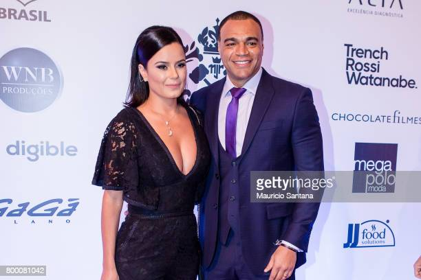 Denilson and Luciele di Camargo poses before a benefit auction at Hotel Unique on June 22, 2017 in Sao Paulo, Brazil.