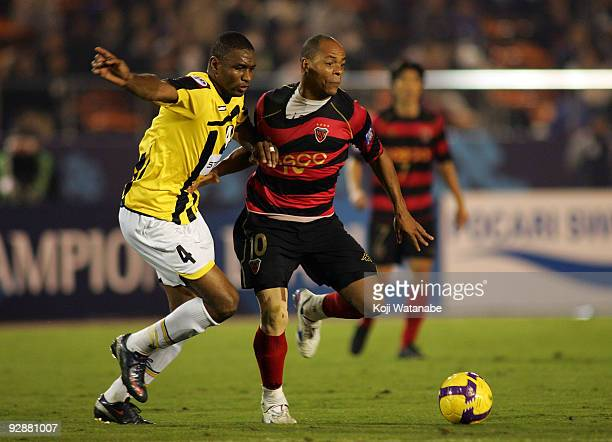 Denilson Martins Nascimento of Pohang Steelers and Takar Redha of Al Ittihad compete for the ball during 2009 AFC Champions League Final match...