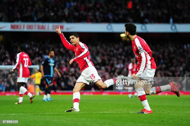 Denilson of Arsenal celebrates scoring the opening goal during the Barclays Premier League match between Arsenal and West Ham United at Emirates...