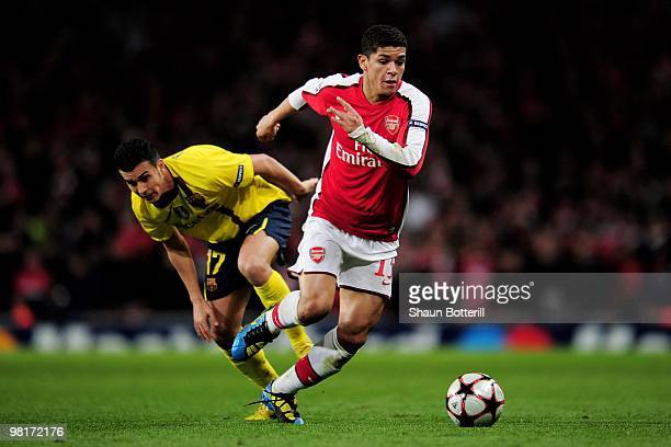 Denilson of Arsenal goes past Pedro Rodriguez of Barcelona during the UEFA Champions League quarter final first leg match between Arsenal and FC...