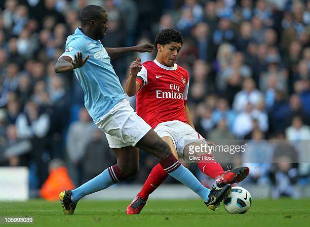Denilson of Arsenal is challenged by Yaya Toure of Manchester City during the Barclays Premier League match between Manchester City and Arsenal at...