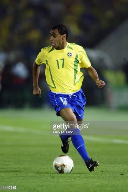 Denilson of Brazil runs with the ball during the Germany v Brazil World Cup Final match played at the International Stadium Yokohama in Yokohama...