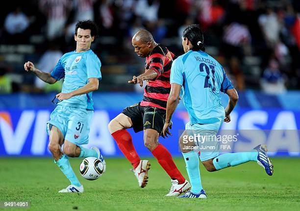 Denilson of Pohang Steelers scores the opening goal past Luis Velasquez and Daniel Arreola of Atlante during the FIFA Club World Cup third place...