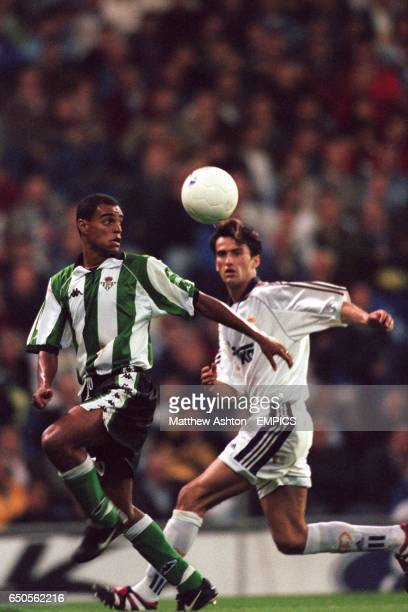 Denilson of Real Betis and Christian Panucci of Real Madrid keep their eyes on the ball