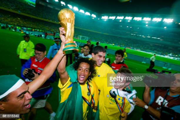 Denilson Ronaldinho Juninho Paulista and Luizao of Brazil celebrate his victory with the World Cup Trophy during the World Cup Final match between...