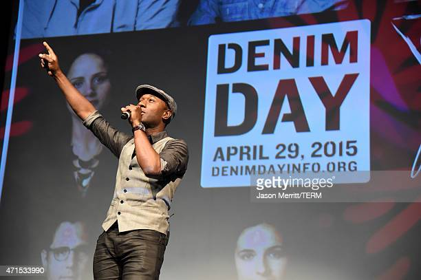 Denim Day 2015 Spokesperson and recording artist Aloe Blacc performs onstage at the GUESS and Peace Over Violence press conference for the 16th...